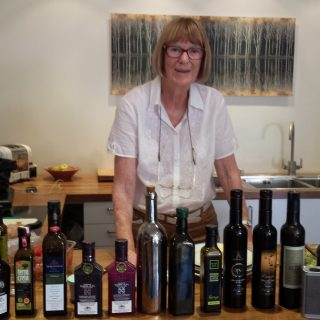 Judy Ridgway with range of oils to taste