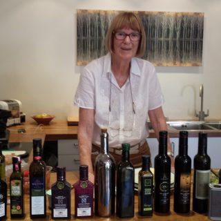 Judy Ridgway with range of oils to taste